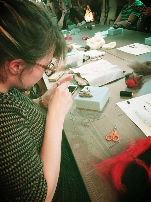 Anna working at Blacksmith Shop Crafts